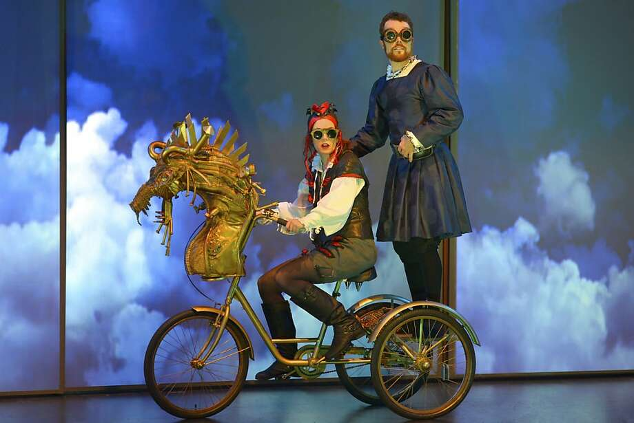 """Mephistopheles (Lyndsy Kail, left) takes Doctor Faustus (Mark Anderson Phillips) on a flight on a magical dragon in San Jose Rep's """"The Tragical History of Doctor Faustus"""" Photo: Kevin Berne"""