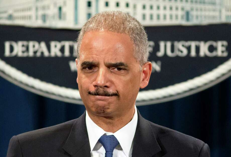 "Attorney General Eric Holder is questioned about the Justice Department secretly obtaining two months of telephone records of reporters and editors for The Associated Press, during a news conference at the Justice Department in Washington, Tuesday, May 14, 2013. In what the news cooperative's top executive called a ""massive and unprecedented intrusion,"" the Justice Department monitored outgoing calls for the work and personal phone numbers of individual reporters, for general AP office numbers in New York, Washington and Hartford, Conn., and for the main number for the AP in the House of Representatives press gallery, according to attorneys for the AP.  (AP Photo/J. Scott Applewhite) Photo: J. Scott Applewhite, STF / AP"