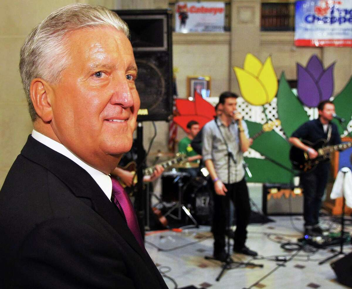 Mayor Jerry Jennings listens as local rock band The City Never Sleeps performs at a news conference to announce details of the 2012 Albany Tulip Festival at Albany City Hall Tuesday April 10, 2012. (John Carl D'Annibale / Times Union)