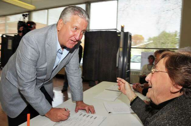Albany Mayor Jerry Jennings, left, signs in with election inspector Mary Oleksak before casting his ballot Tuesday morning November 3, 2009.  (John Carl D'Annibale / Times Union) Photo: John Carl D'Annibale / 00006221A