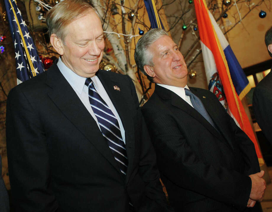 TIMES UNION PHOTO BY LUANNE M. FERRIS      Monday, Jan. 16, 2006, Albany, NY, L-R: New York State Gov. George Pataki,  visited Albany City Hall to announce plans for a new convention center to be built in the capital city within one mile of the Empire State Plaza.  On hand for the announcement,  Jerry Jennings, Albany Mayor, confers with the Gov., during the press conference.  Patiki announced that he is putting $75 million in his Executive Budget to spearhead the project which will include a hotel for the downtown setting. Photo: LMF / ALBANY TIMES UNION