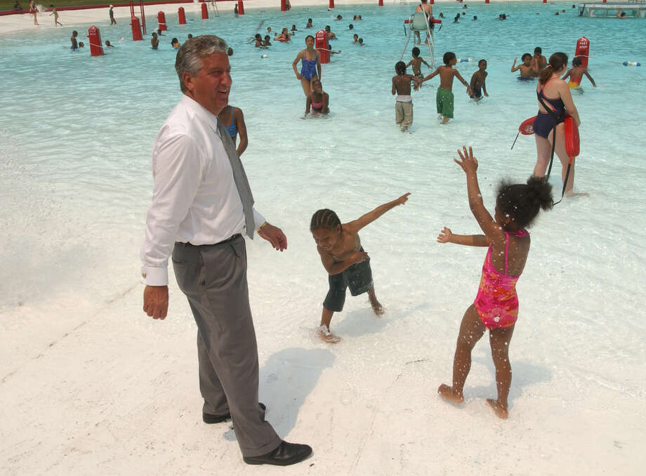 Times Union Staff Photo by Skip Dickstein - Mayor Jerry Jennings greets some of the first local kids to come into the Lincoln Park pool on opening day in Albany, New York June 27, 2003. Photo: SKIP DICKSTEIN / ALBANY TIMES UNION