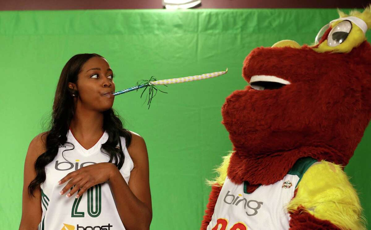 Seattle Storm's Camille Little, left, teases team mascot Doppler during a video session Tuesday, May 14, 2013, at the team's media day in Seattle. The Storm opens their WNBA basketball season Sunday, May 26, at Los Angeles.