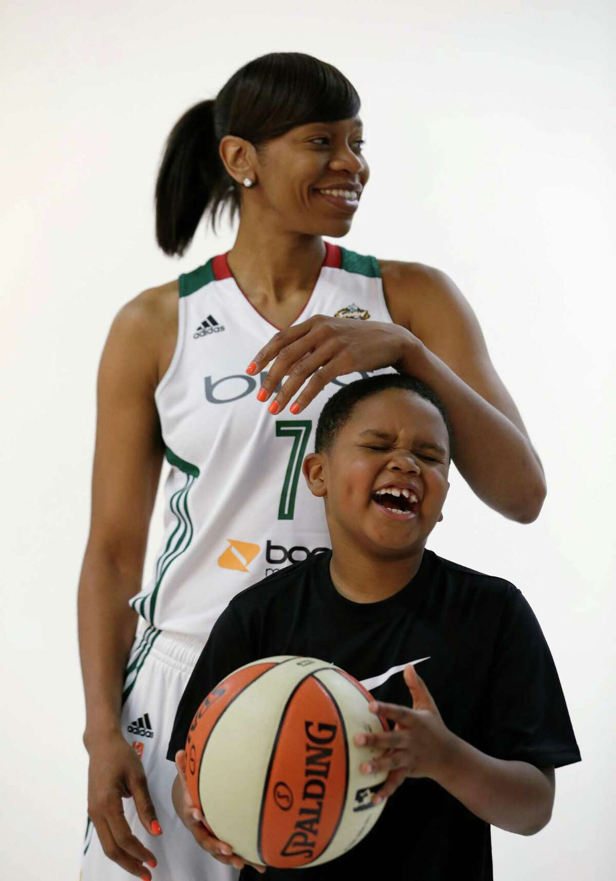 Seattle Storm's Tina Thompson teases her son, Dyllan Thompson Jones, 8, while being photographed Tuesday, May 14, 2013, during the team's media day in Seattle. The Storm opens their WNBA basketball season Sunday, May 26, at Los Angeles.