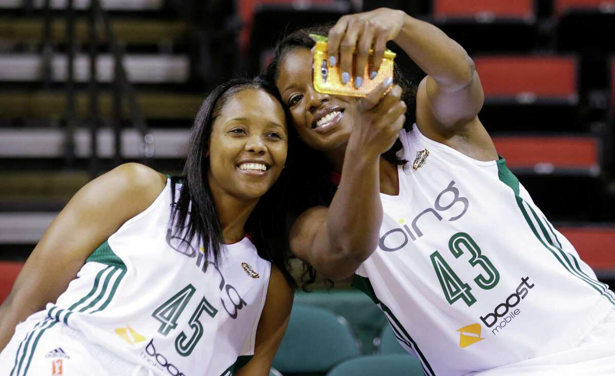 Seattle Storm's Noelle Quinn (45) and Nakia Sanford take their photo together Tuesday, May 14, 2013, during the team's media day in Seattle. The Storm opens their WNBA basketball season Sunday, May 26, at Los Angeles.