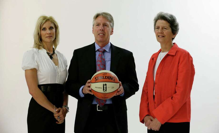 Seattle Storm head coach Brian Agler, center, poses for a portrait with assistant coaches Jenny Boucek, left, and Nancy Darsch Tuesday, May 14, 2013 during the team's media day in Seattle.  The Storm opens their regular season Sunday, May 26, at Los Angeles. Photo: Elaine Thompson, AP / AP