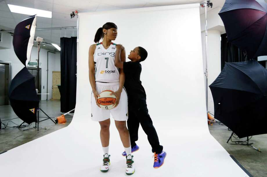 Seattle Storm's Tina Thompson is photographed with her son, Dyllan Thompson Jones, 8, Tuesday, May 14, 2013, during the team's media day in Seattle. The Storm opens their WNBA basketball season Sunday, May 26, at Los Angeles. Photo: Elaine Thompson, AP / AP