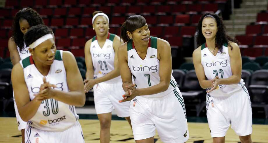 Seattle Storm players Tanisha Wright (30), Tianna Hawkins (21), Tina Thompson (7) and Alysha Clark practice a dance move during a video session Tuesday, May 14, 2013 during the team's media day in Seattle. The Storm opens their regular season Sunday, May 26, at Los Angeles. Photo: Elaine Thompson, AP / AP