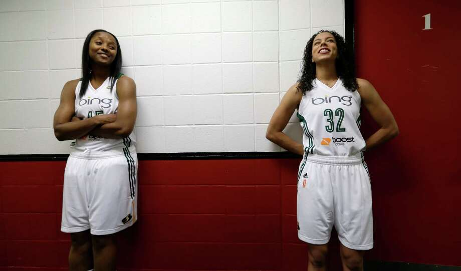Seattle Storm's Noelle Quinn, left, and Alysha Clark wait in a hallway Tuesday, May 14, 2013 during the team's media day in Seattle.  The Storm opens their regular season Sunday, May 26, at Los Angeles. Photo: Elaine Thompson, AP / AP