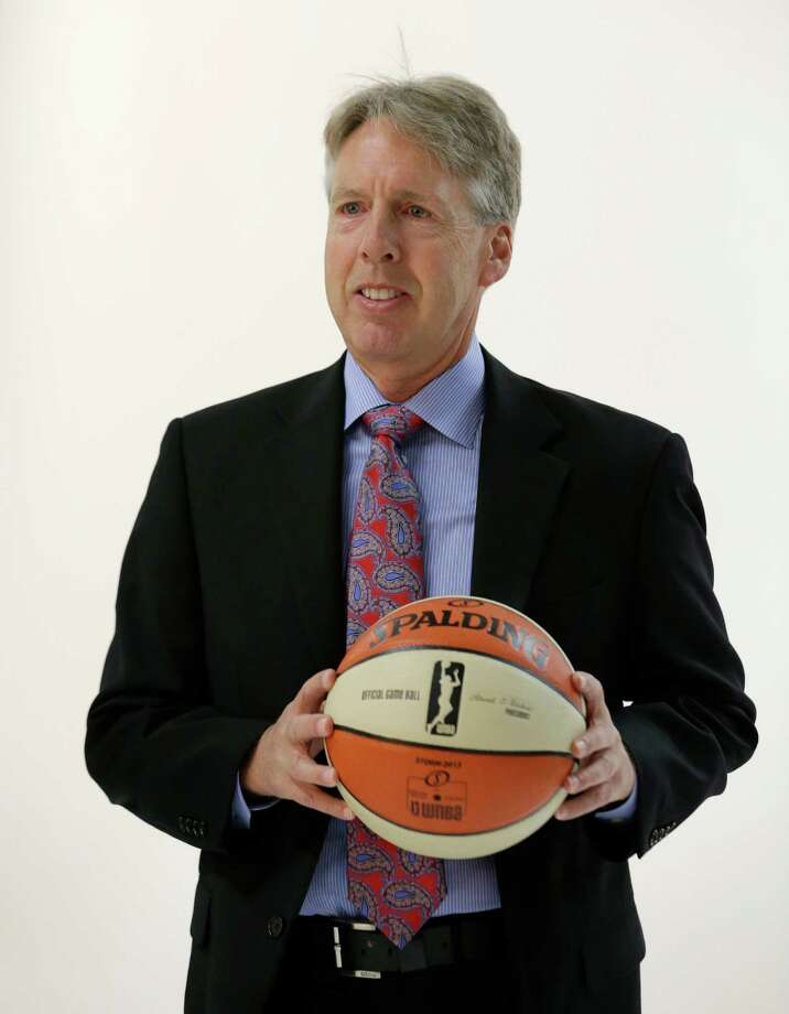 Seattle Storm head coach Brian Agler, center, poses for a portrait Tuesday, May 14, 2013 during the team's media day in Seattle.  The Storm opens their regular season Sunday, May 26, at Los Angeles. Photo: Elaine Thompson, AP / AP