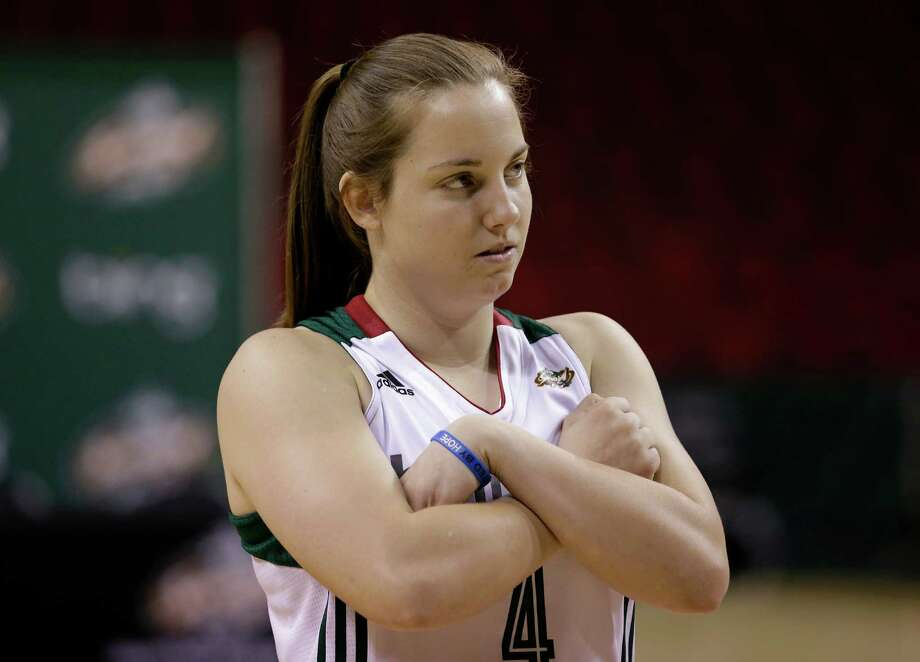 Seattle Storm's Samantha MacKay waits between shooting sessions Tuesday, May 14, 2013 during the team's media day in Seattle. The Storm opens their regular season Sunday, May 26, at Los Angeles. Photo: Elaine Thompson, AP / AP
