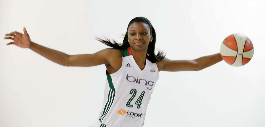 Seattle Storm's Keisha Hampton spreads her arms during a photo shoot, Tuesday, May 14, 2013, at the team's media day in Seattle. The Storm opens their WNBA basketball season Sunday, May 26, at Los Angeles. Photo: Elaine Thompson, AP / AP
