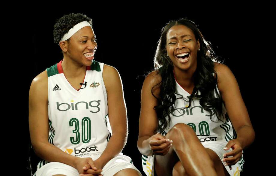 Seattle Storm's Camille Little, right, laughs as she sits with Tanisha Wright during a video session, Tuesday, May 14, 2013, at the team's media day in Seattle. The Storm opens their WNBA basketball season Sunday, May 26, at Los Angeles. Photo: Elaine Thompson, AP / AP