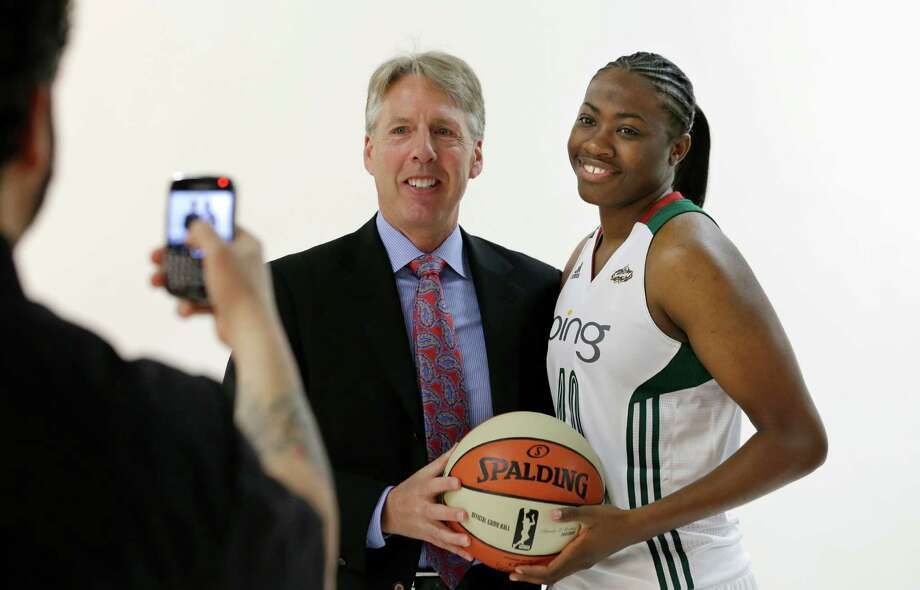Seattle Storm head coach Brian Agler, left, is photographed on his cell phone with Shekinna Stricklen, Tuesday, May 14, 2013, at the team's media day in Seattle. The Storm opens their WNBA basketball season Sunday, May 26, at Los Angeles. Photo: Elaine Thompson, AP / AP