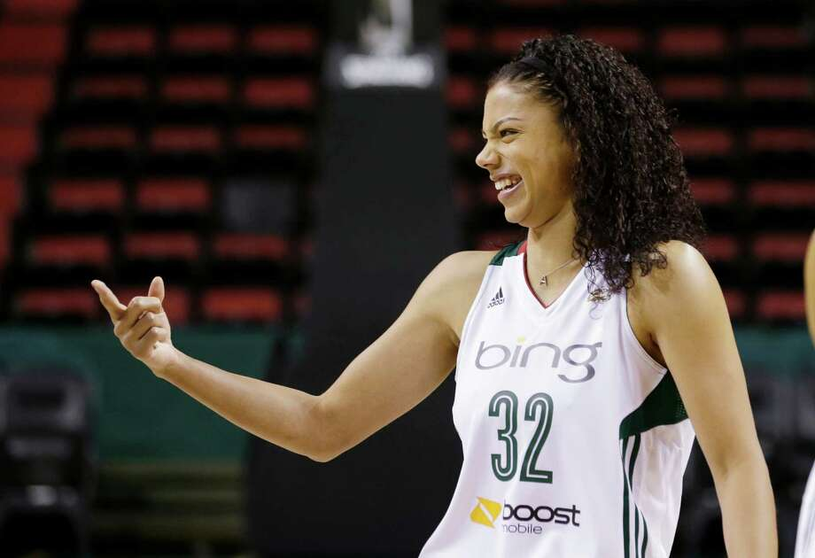 Seattle Storm's Alysha Clark laughs with a teammate Tuesday, May 14, 2013 during the team's media day in Seattle. The Storm opens their regular season Sunday, May 26, at Los Angeles. Photo: Elaine Thompson, AP / AP