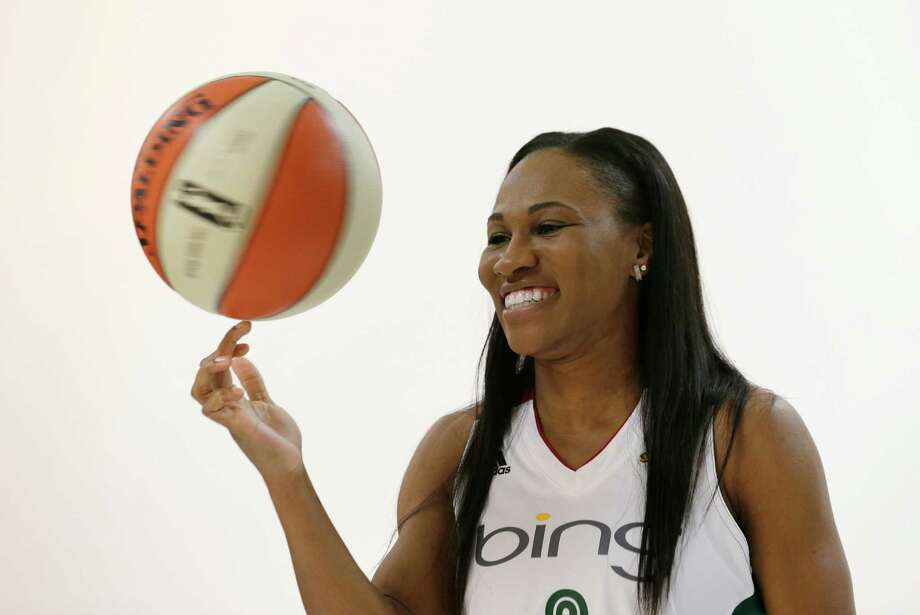 Seattle Storm's Temeka Johnson spins a basketball during a photo shoot, Tuesday, May 14, 2013, at the team's media day in Seattle. The Storm opens their WNBA basketball season Sunday, May 26, at Los Angeles. Photo: Elaine Thompson, AP / AP