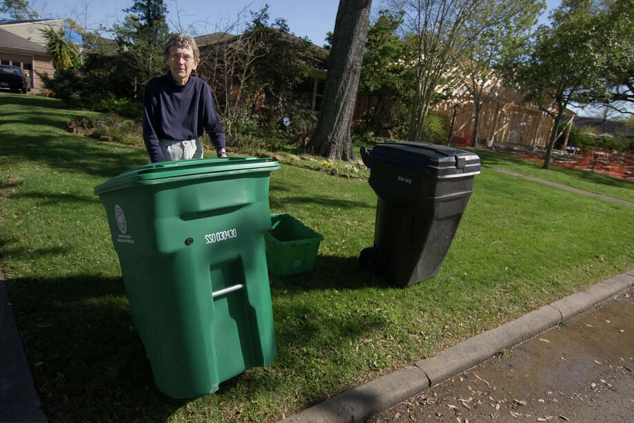 Julie Souchek shows the new green recycling container she and her neighbors received for use in Houston's curbside recycling program in this 2010 photo.  Many residents in the Westridge neighborhood began using the containers immediately, although the program for which they are intended did not begin until April.  Photo by R. Clayton McKee Photo: R. Clayton McKee, For The Chronicle / Freelance