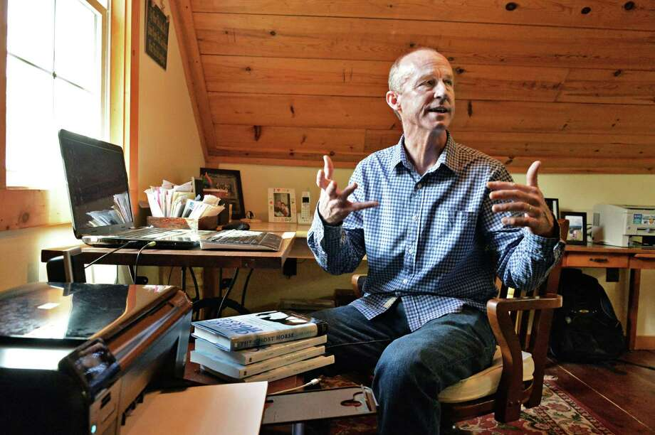 """Author Joe Layden at his writing desk in the 19th C. foaling house that serves as his studio at his Saratoga Springs,NY home Thursday May 9, 2013. Joe's latest book, """"Ghost Horse,"""" tells the inspiring story of Lisa's Booby Trap and its trainer.  (John Carl D'Annibale / Times Union) Photo: John Carl D'Annibale / 00022357A"""