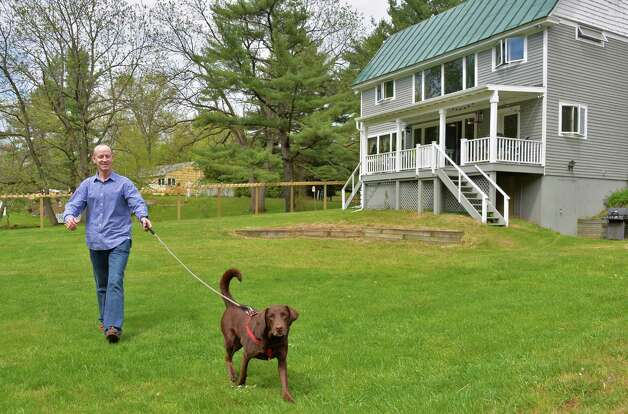 "Author Joe Layden with his dog ""Hudson"" outside his Saratoga Springs, NY home Thursday May 9, 2013. Joe's latest book, ""Ghost Horse,"" tells the inspiring story of Lisa's Booby Trap and its trainer.  (John Carl D'Annibale / Times Union) Photo: John Carl D'Annibale / 00022357A"