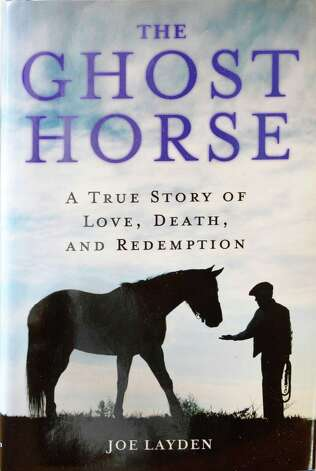 "Cover of author Joe Layden's new book ""Ghost Horse,"" the inspiring story of Lisa's Booby Trap and its trainer in the studio of his Saratoga Springs, NY home Thursday May 9, 2013. (John Carl D'Annibale / Times Union) Photo: John Carl D'Annibale / 00022357A"