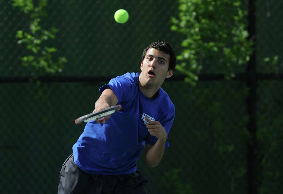 Abbott Tech.'s Rafael DosSantos serves in the tennis match between Abbott Tech. and Wilcox Tech. at Henry Abbott Technical High School in Danbury, Conn. on Tuesday, May 14, 2013.  DosSantos won his match, but Wilcox Tech. defeated Abbott Tech. overall, 5-2. Photo: Tyler Sizemore / The News-Times