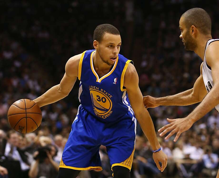 SAN ANTONIO, TX - MAY 14:   Stephen Curry #30 of the Golden State Warriors dribbles the ball against Tony Parker #9 of the San Antonio Spurs during Game Five of the Western Conference Semifinals of the 2013 NBA Playoffs at AT&T Center on May 14, 2013 in San Antonio, Texas.  NOTE TO USER: User expressly acknowledges and agrees that, by downloading and or using this photograph, User is consenting to the terms and conditions of the Getty Images License Agreement.  (Photo by Ronald Martinez/Getty Images) Photo: Ronald Martinez, Getty Images