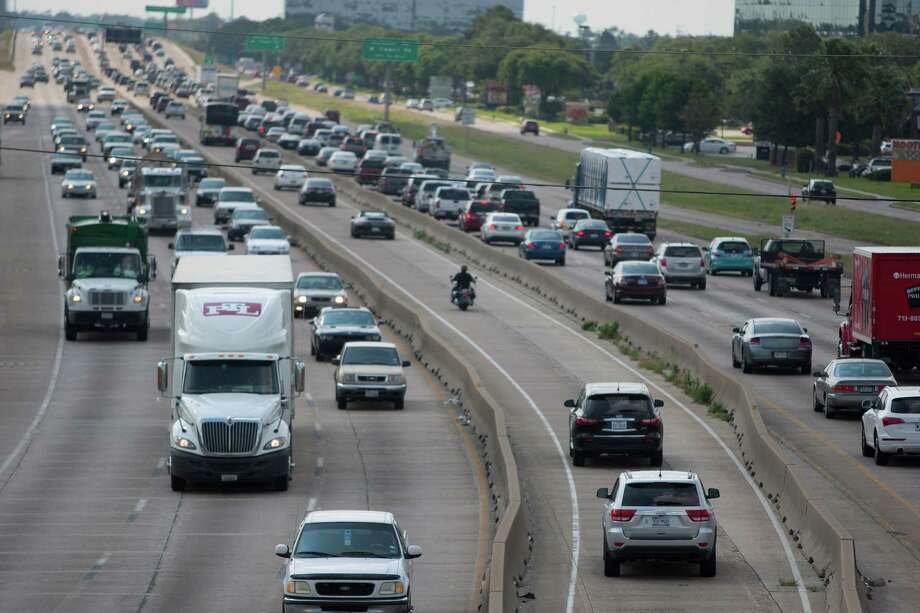 Drivers head northwestbound in the HOV lane on U.S. 290 Tuesday, May 14, 2013, in Houston. Starting Monday, solo drivers will be able to pay between $1 and $5 for using the lanes while eligible carpoolers can still use them for free. Photo: Johnny Hanson, Houston Chronicle / © 2013  Houston Chronicle