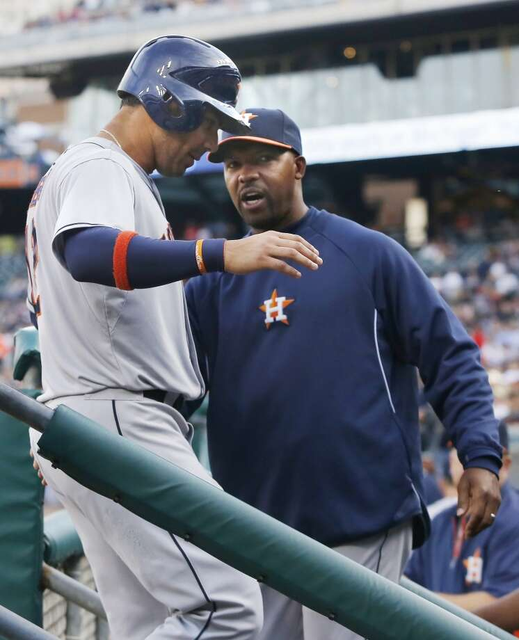 Astros manager Bo Porter congratulates Carlos Pena on scoring a run.