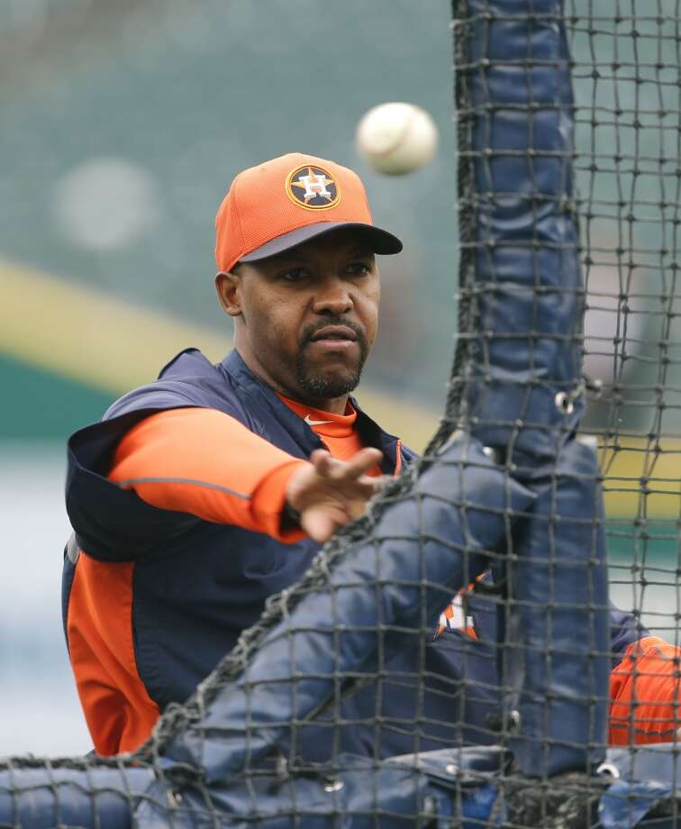 Astros manager Bo Porter delivers a pitch during batting practice.