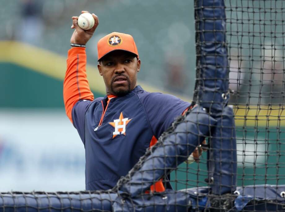 Astros manager Bo Porter winds up to throw a pitch during batting practice.