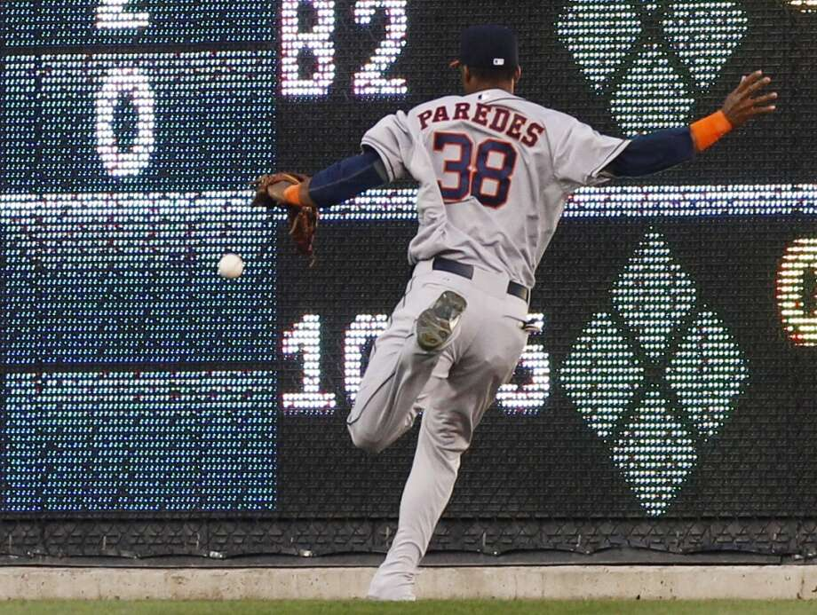 May 14: Tigers 6, Astros 2 Astros outfielder Jimmy Paredes tries to chase down a ball.