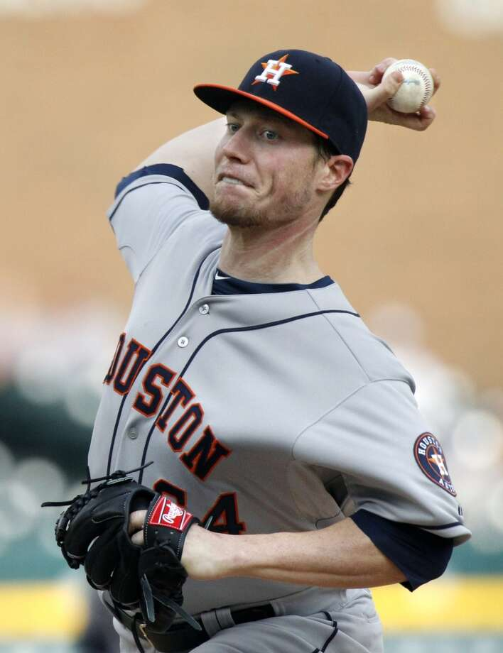 Lucas Harrell of the Astros delivers a pitch to the Tigers.