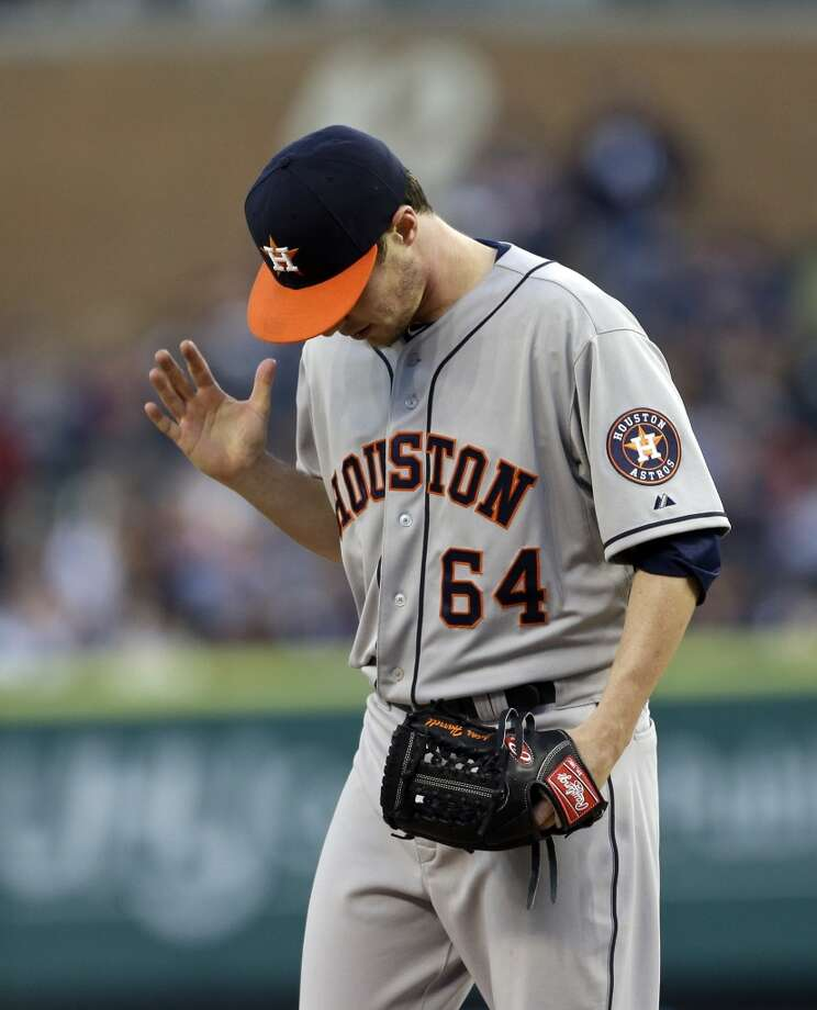 Astros pitcher Lucas Harrell reacts after giving up a double during the fifth inning.