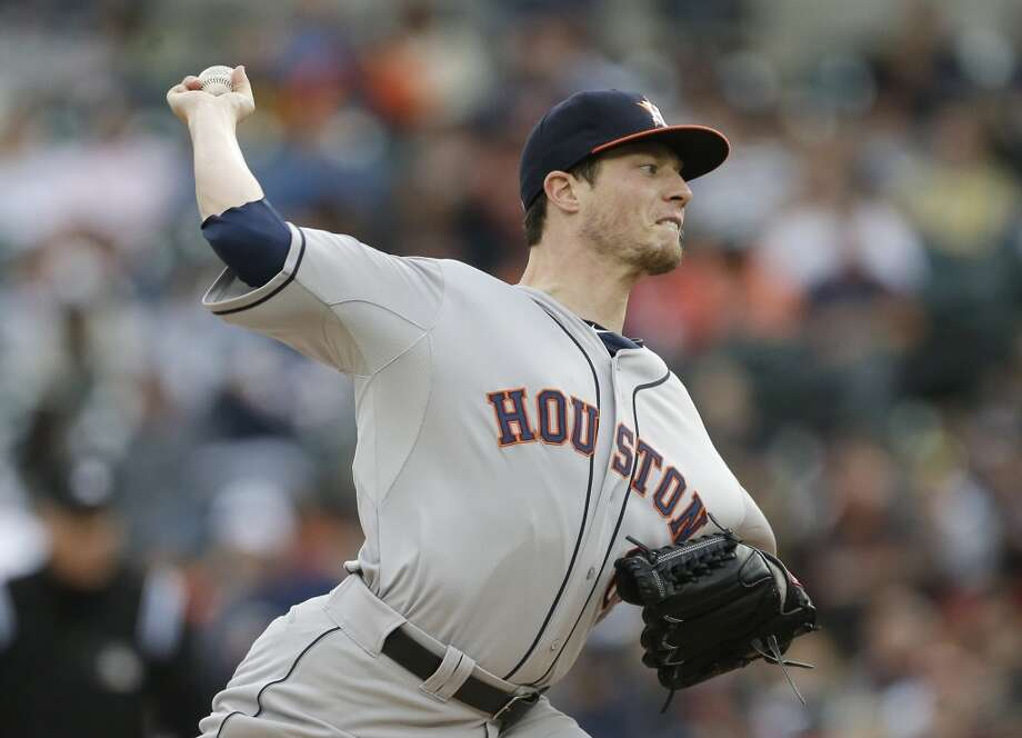 Astros pitcher Lucas Harrell delivers a pitch against the Tigers.