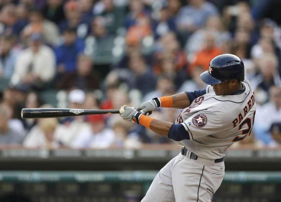 Jimmy Paredes of the Astros scores Carlos Pena on a sacrifice fly during the second inning.