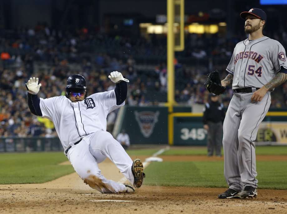 Prince Fielder of the Tigers scores on a wild pitch against the Astros.