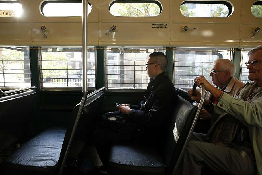 Boden Zhou (left), 16, rides the F-Market streetcar in San Francisco. His generation is increasingly forgoing getting driver's licenses and choosing public transportation, in a surprising cultural change. Photo: Carlos Avila Gonzalez, The Chronicle