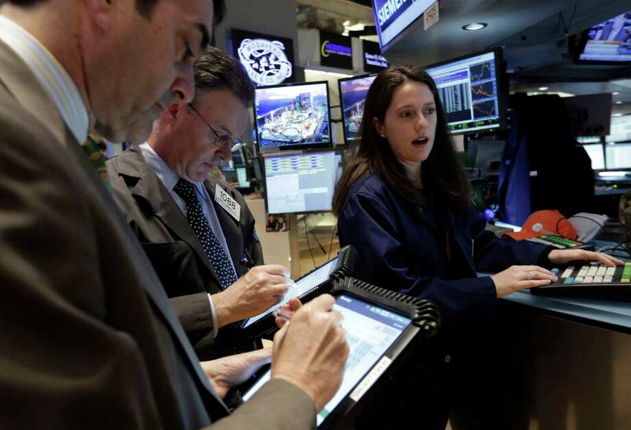In this Friday, April 12, 2013. photo, specialist Allison Gamba works at her post on the floor of the New York Stock Exchange. Financial markets remained subdued Tuesday May 14, 2013 as investors assessed whether the recent optimism that has seen many stock indexes hit historic highs will last.(AP Photo/Richard Drew) Photo: Richard Drew, STF / AP