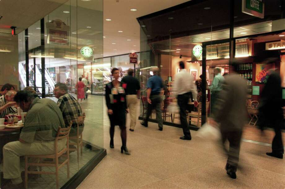 In downtown Houston, a seven-mile, climate-controlled pedestrian tunnel links major buildings, offering visitors an array of restaurants, shops and other services. Photo: Betty Tichich, Staff / Houston Chronicle