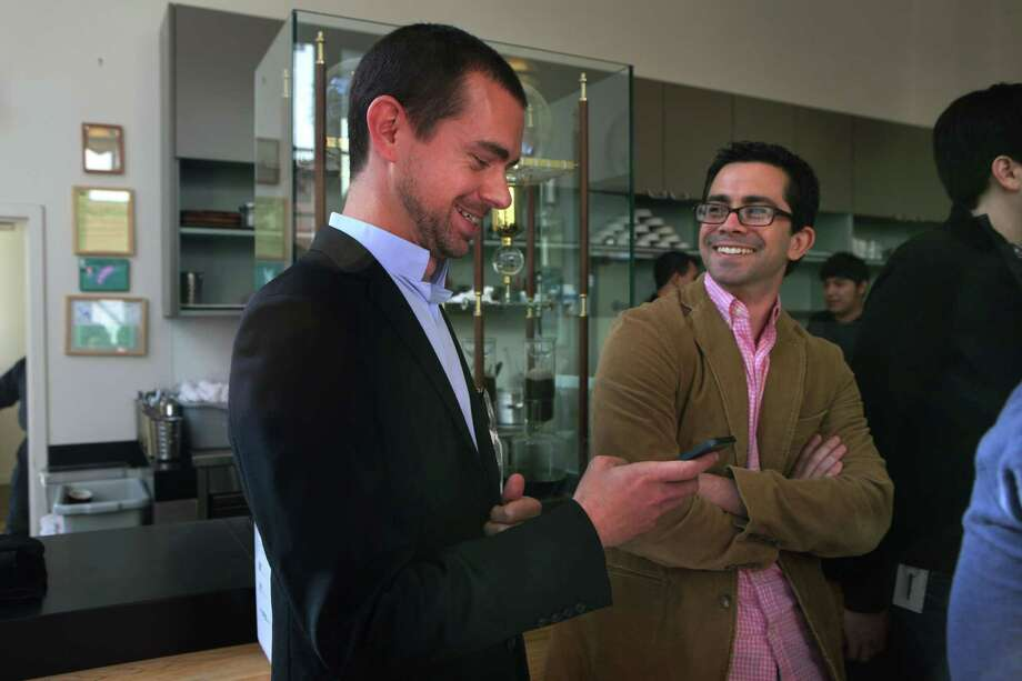 Square CEO Jack Dorsey and Square spokesperson Aaron Zamost (right) introduce the Square Stand, a new point of sale device, at Blue Bottle in San Francisco, Calif., on Tuesday, May 14, 2013.  The Stand hardware secures an iPad with an integrated credit card reader and has plug ins for barcode scanners, customer receipts, and other merchant needs. Photo: Liz Hafalia, Staff / ONLINE_YES