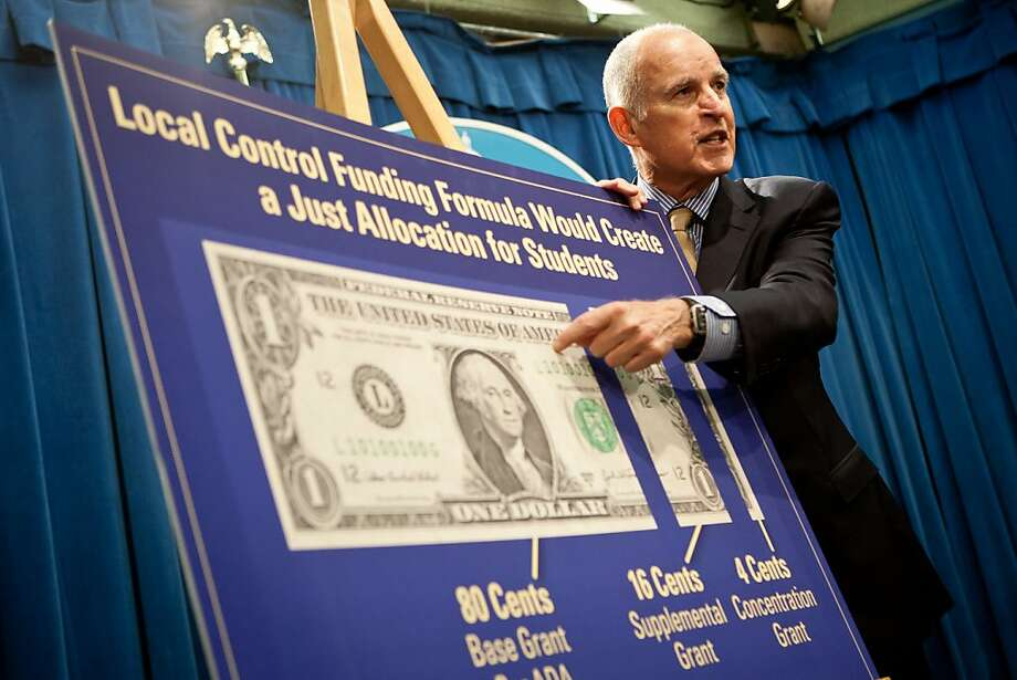 Gov. Jerry Brown points to a graph detailing increased school spending during a press conference. Photo: Max Whittaker/Prime, Special To The Chronicle