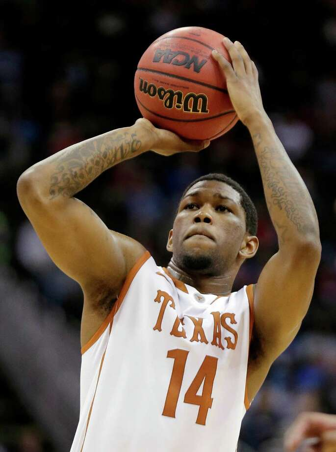 Texas guard Julien Lewis (14) shoots against TCU during the first half of an NCAA college basketball game in the Big 12 tournament, Wednesday, March 13, 2013, in Kansas City, Mo. Texas won 70-57. (AP Photo/Charlie Riedel) Photo: Charlie Riedel, STF / AP