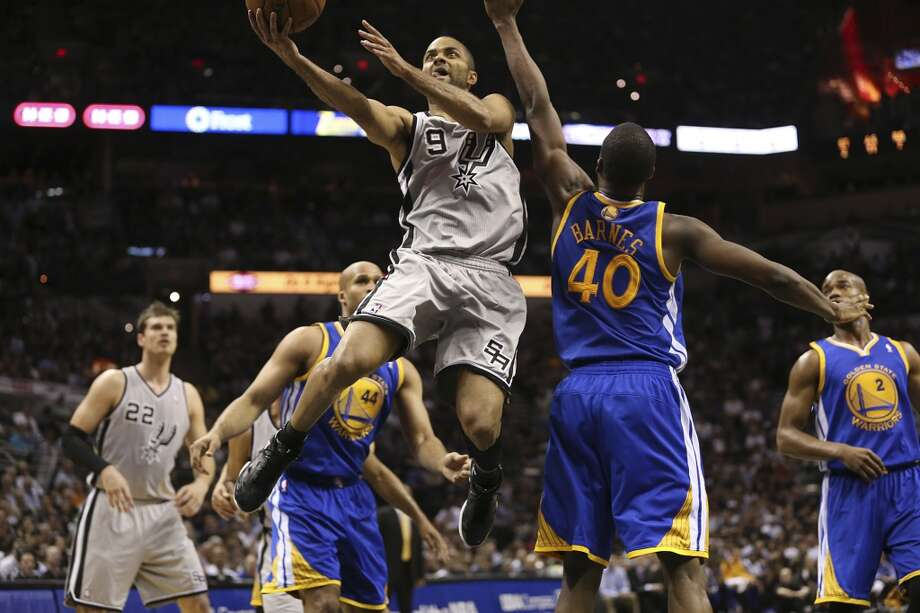 The Spurs' Tony Parker drives by the Warriors' Richard Jefferson (44) and Harrison Barnes during the first half of Game 5 in the NBA Western Conference semifinals at the AT&T Center, Tuesday, May 14, 2013. Photo: Jerry Lara, San Antonio Express-News