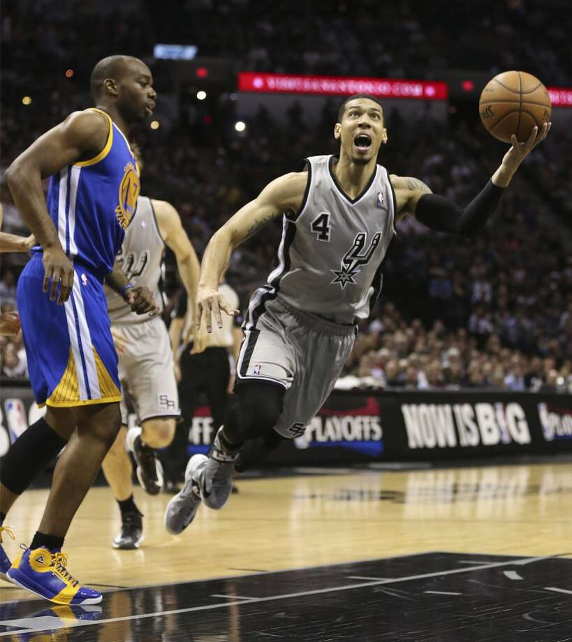 The Spurs' Danny Green is fouled as he drive by the Warriors' Carl Landry during the first half of Game 5 in the NBA Western Conference semifinals at the AT&T Center, Tuesday, May 14, 2013. Photo: Jerry Lara, San Antonio Express-News