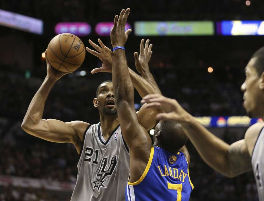The Spurs' Tim Duncan scores over the Warriors' Carl Landry during the first half of Game 5 in the NBA Western Conference semifinals at the AT&T Center, Tuesday, May 14, 2013. Photo: Jerry Lara, San Antonio Express-News