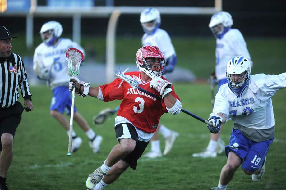 Guilderland senior midfielder Stephen Polsinelli, center, during their game against Shaker on Tuesday May 14, 2013 in Latham, N.Y. (Michael P. Farrell/Times Union) Photo: Michael P. Farrell