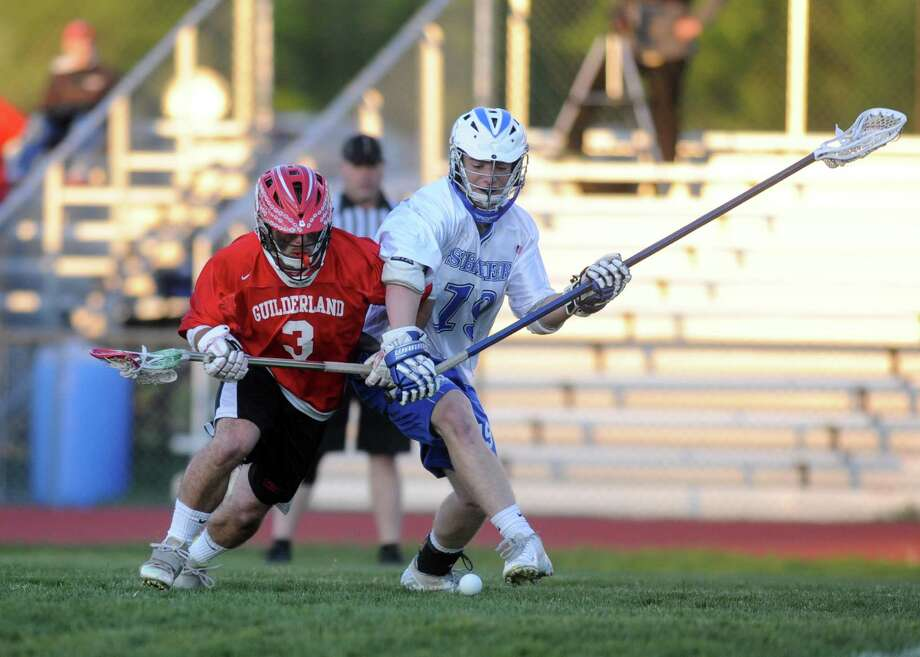 Guilderland's Stephen Polsinelli and Shaker's Billy Blatter battle for the ball during their boy's high school lacrosse game on Tuesday May 14, 2013 in Latham, N.Y. (Michael P. Farrell/Times Union) Photo: Michael P. Farrell