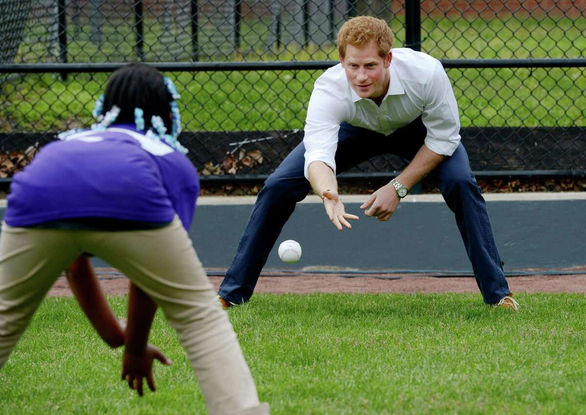 Britain's Prince Harry participates in a baseball clinic during the launch of a new partnership between the Royal Foundation of the Duke and Duchess of Cambridge and Harlem RBI, a local community organization, in New York on Tuesday, May 14, 2013. Prince Harry is in the midst of weeklong visit to the United States. (AP Photo/Justin Lane, Pool)