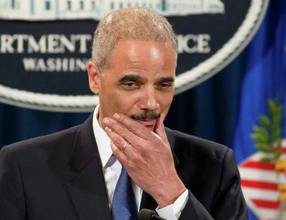 Attorney General Eric Holder pauses during a news conference at the Justice Department in Washington, Tuesday, May 14, 2013. Holder said he's ordered a Justice Department investigation into the Internal Revenue Service's targeting of conservative groups for extra tax scrutiny.   (AP Photo/J. Scott Applewhite) Photo: J. Scott Applewhite