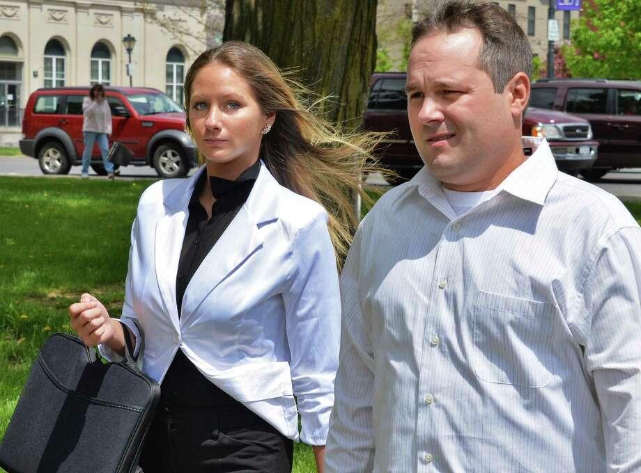 Sno Kone Joe owner Amanda Scott and Joshua Malatino outside Fulton County Court House in Johnstown, NY Tuesday May 14, 2013.  (John Carl D'Annibale / Times Union) Photo: John Carl D'Annibale / 00022394A